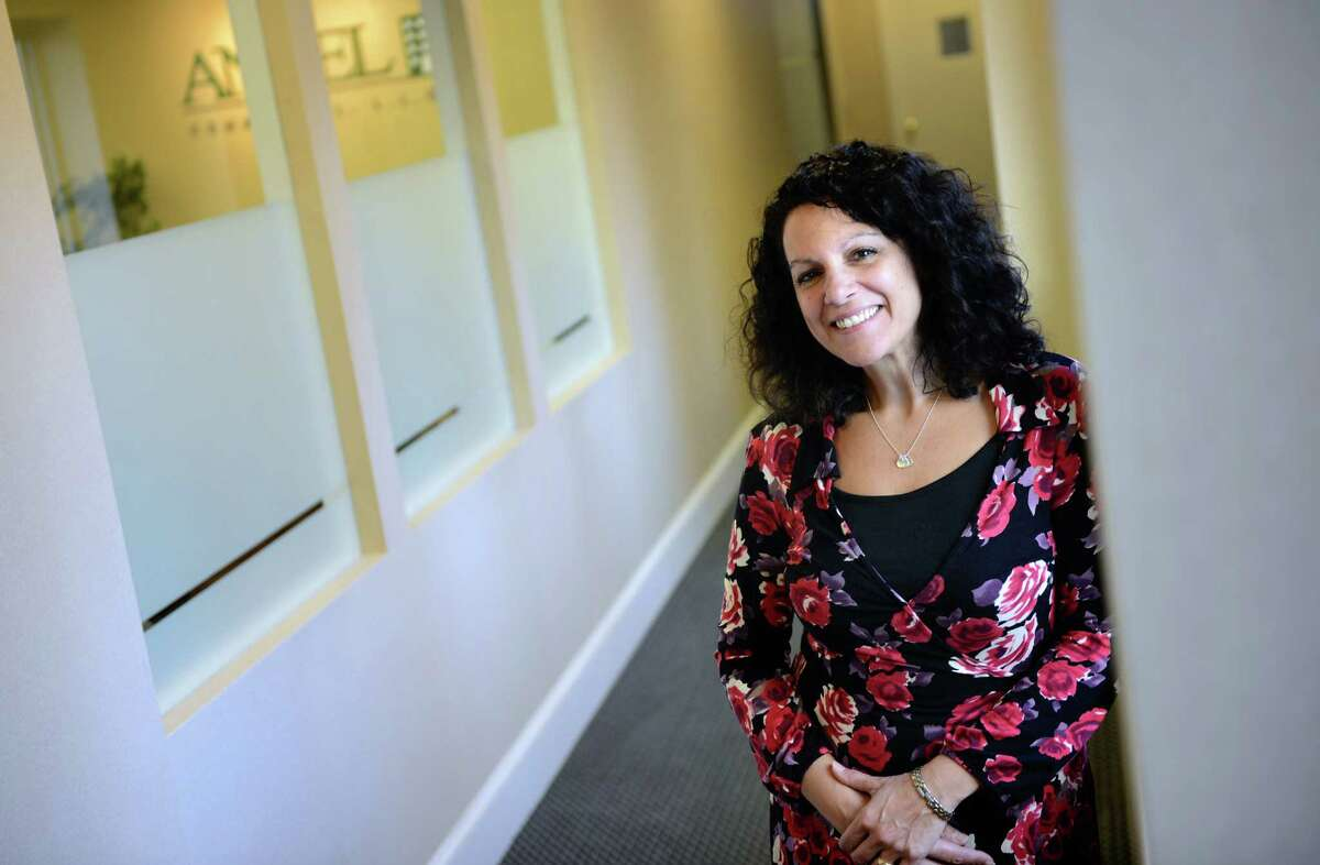 Nili Walp, director of marketing for Angel Commercial, LLC, poses for a photograph at the company's office in Fairfield, Conn.
