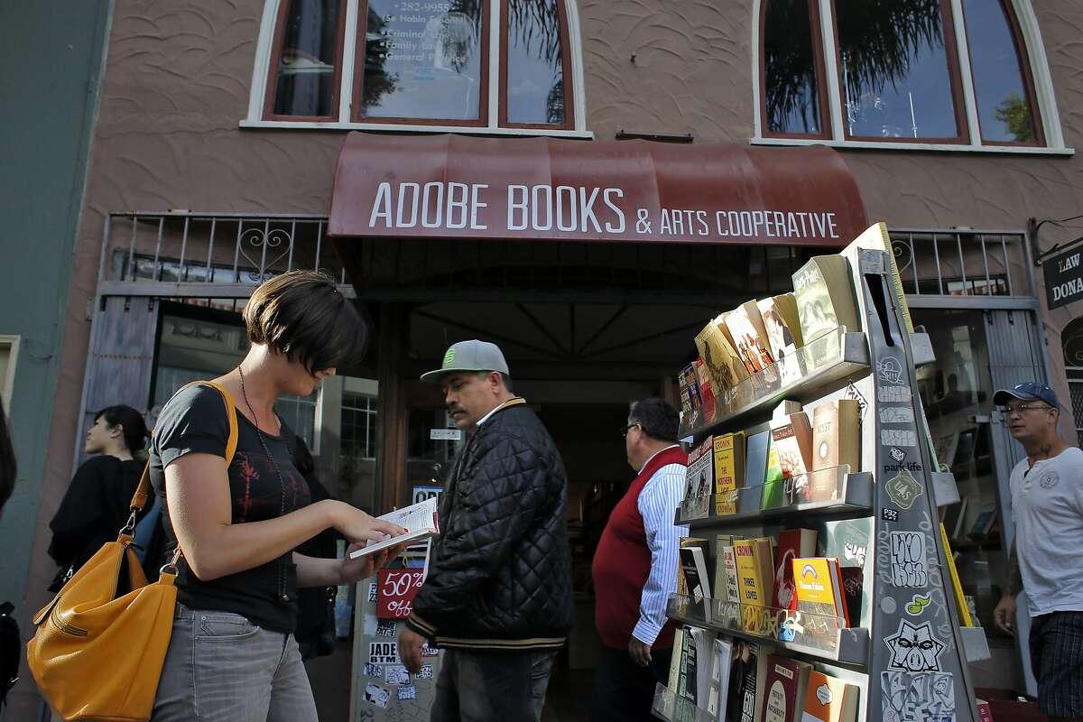 cassandra mayal of san francisco browses at adobe books arts cooperative on 24th street photo by carlos avila gonzalez adobe san francisco