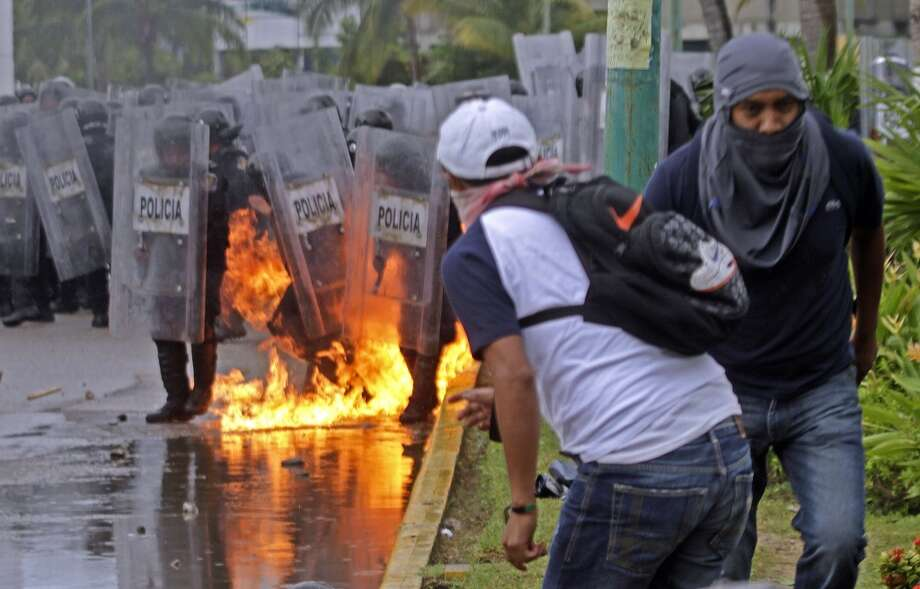 Demonstrators protest government corruption in Iguala, Mexico. Photo: PEDRO PARDO, AFP/Getty Images