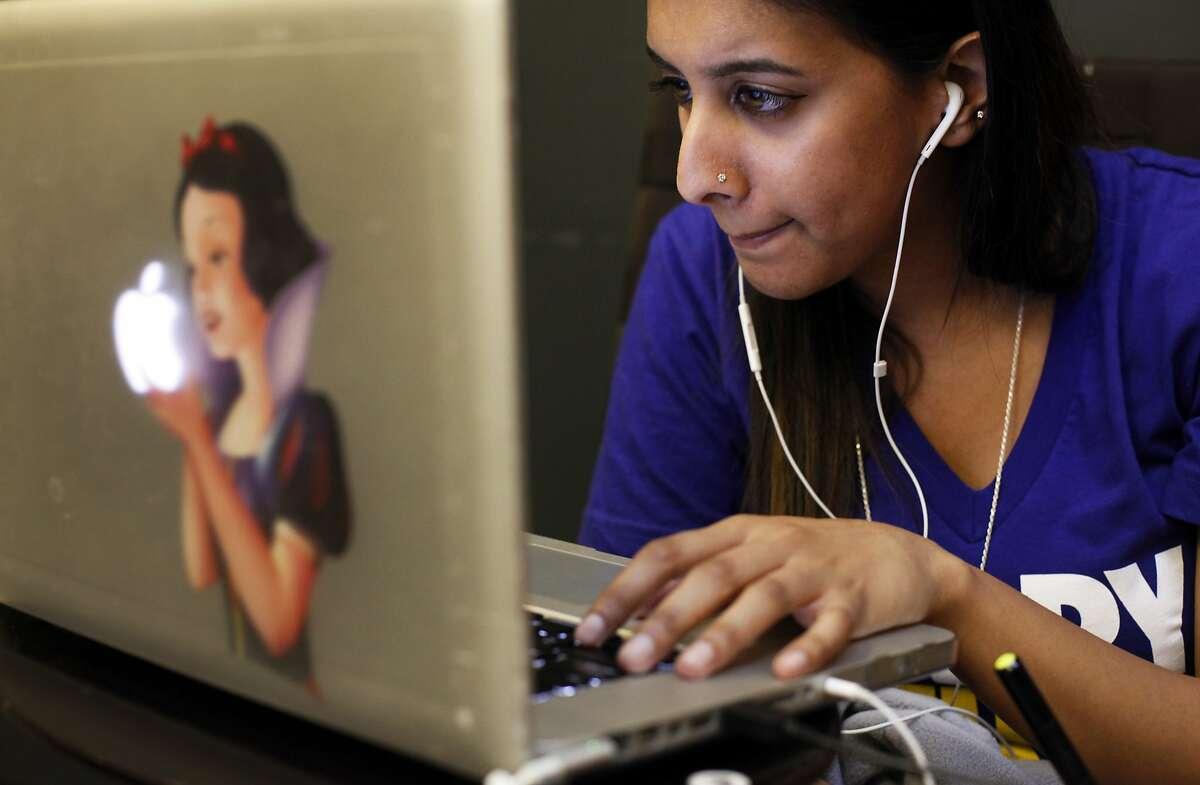 Anjali Sharma works to design a banner ad for a startup called Mistobox at Workshop Cafe on November 11, 2014 in San Francisco, Calif.