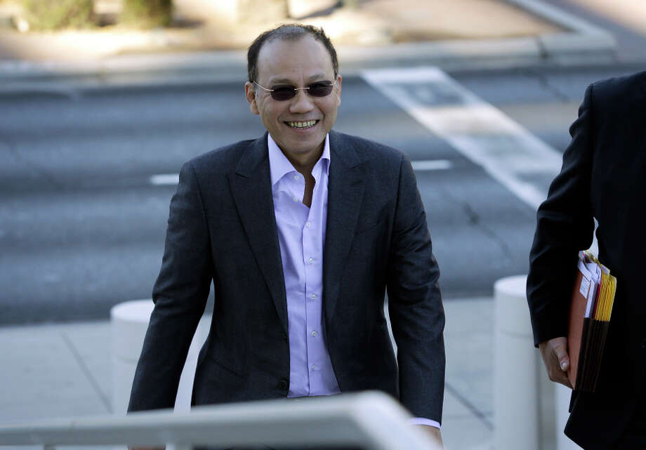 Wei Seng Phua walks into court in Las Vegas. Phua, his son Darren Wai Kit Phua, and six others were arrested after federal agents raided high-roller villas at Caesars Palace. Photo: John Locher / Associated Press / AP