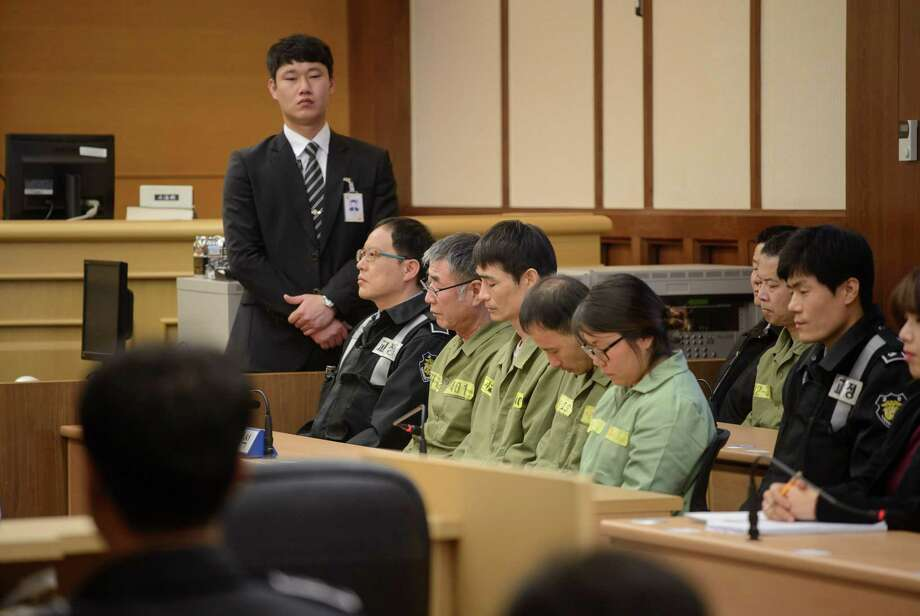 Lee Jun-seok, 69, seated second from left, captain of the Sewol ferry that sank last April killing more than 300 people, waits with fellow crew members for the verdict in their trial  in Gwangju, South Korea, Nov. 11, 2014. The captain was sentenced Tuesday to 36 years in prison for deserting his ship and its passengers in a fatal crisis. But he was acquitted of murder, infuriating family members of some of the victims in the countryé¢Â€Â™s worst disaster in decades. (Ed Jones/Pool via The New York Times) -- FOR EDITORIAL USE ONLY. -- Photo: ED JONES, POOL / POOL