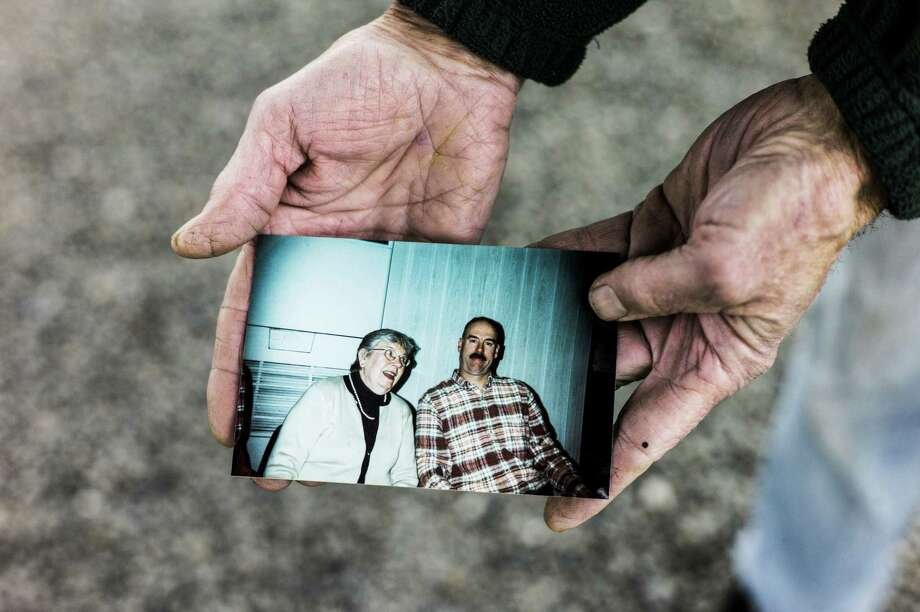 Sam Averill holds a photograph of his mother, Jean Averill, and his brother Mark in Washington, Conn., Nov. 6, 2014. Jean Averill is among the 13 victims that General Motors linked to the ignition switch defect, but the family says even today the company has not told them about the connection. Photo: MISHA FRIEDMAN, Misha Friedman/New York Times / Misha Friedman/The New York Times News Times Contributed