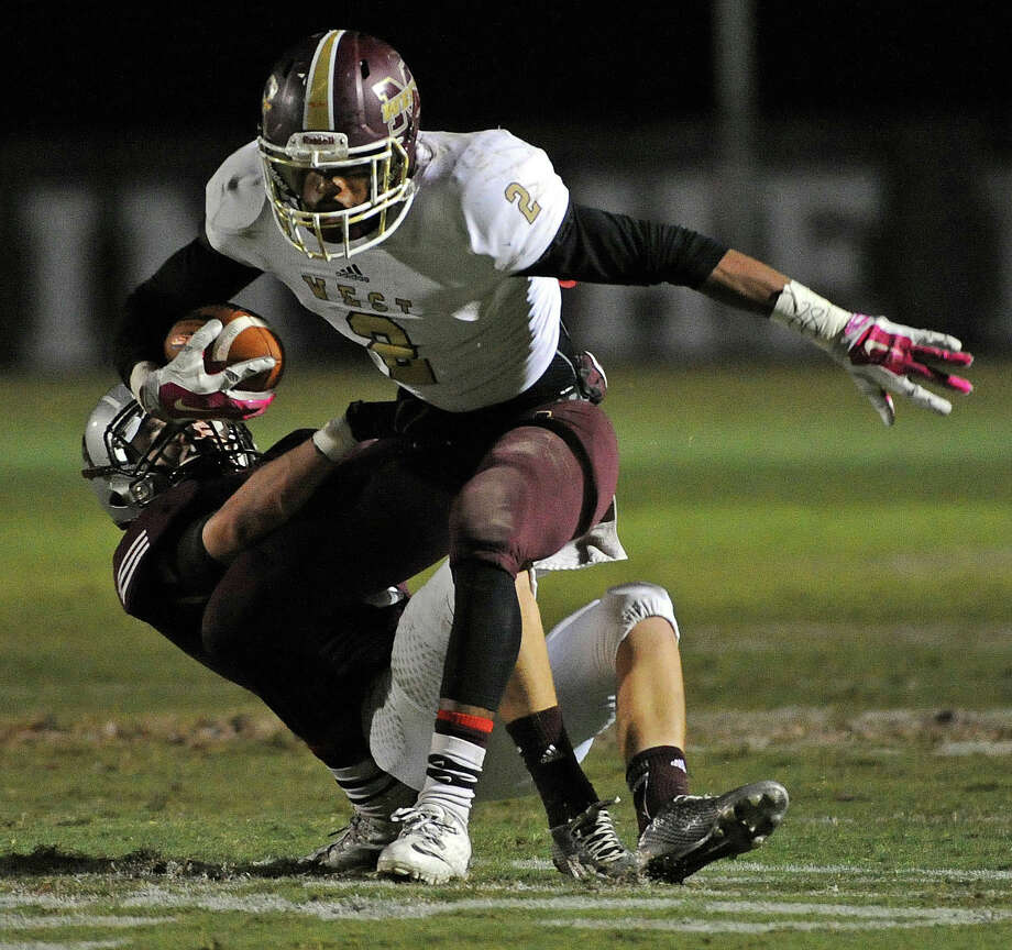 Magnolia West wide receiver Damarren Mitchell, right, is tackled by Magnolia defensive back Bobby Baker during the first half of the Mustangs' win last week. Photo: Eric Christian Smith, Freelance / 2014 Eric Christian Smith
