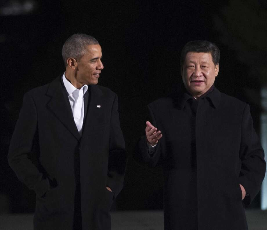 President Obama (left) and President Xi Jinping talk before a dinner in Beijing. Photo: MANDEL NGAN / AFP/Getty Images / AFP