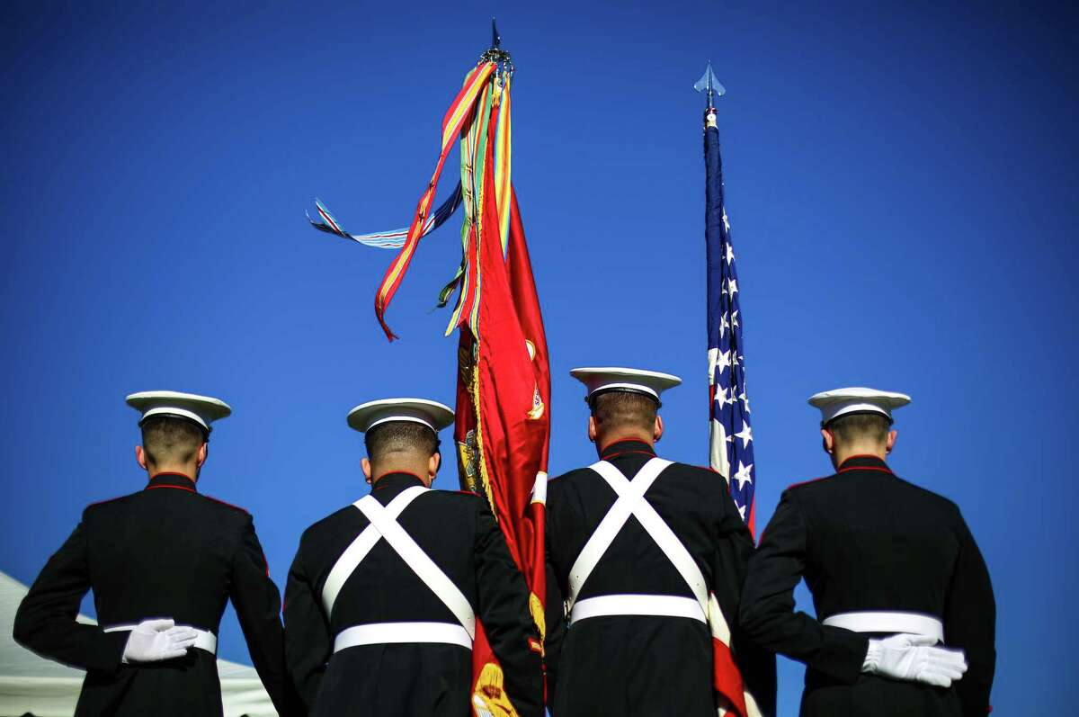Marines present the colors during a ceremony at Evergreen Washelli Cemetery honoring past and current military members.