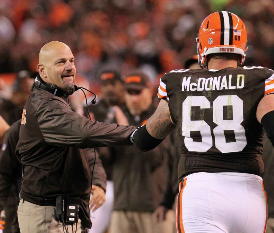 First-year coach Mike Pettine, left, downplays the Browns' 6-3 start. Photo: PHIL MASTURZO, MBR / Akron Beacon Journal