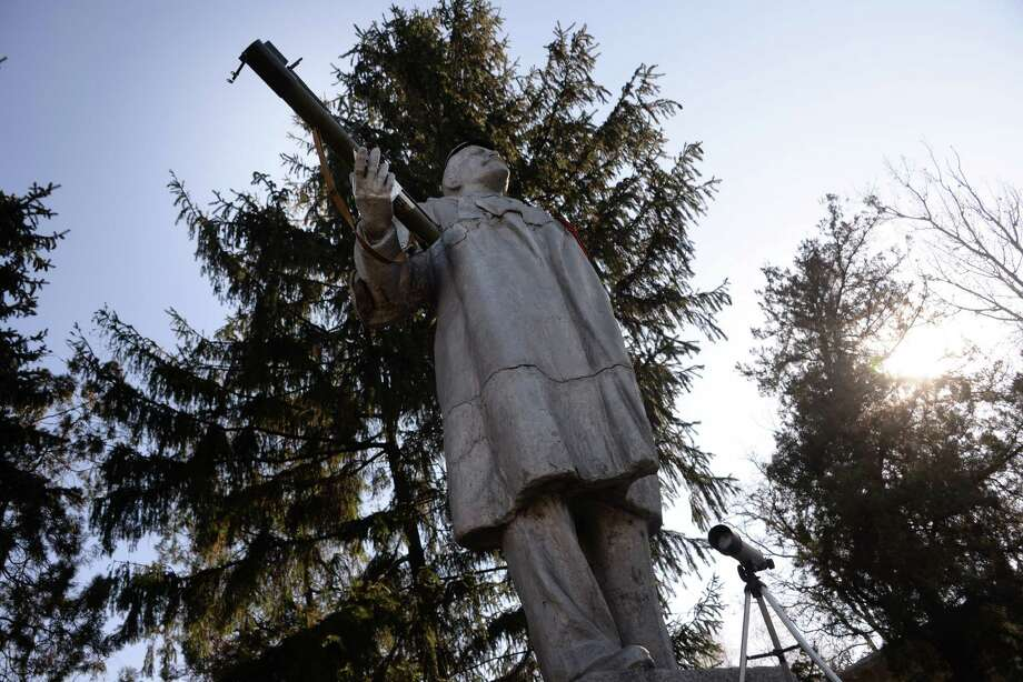 In this Wednesday Nov. 5, 2014 photo, a statue of the Soviet founder Vladimir Lenin with a grenade launcher fixed in a hand is situated at one of the Cossacks check-points at Miusinsk, Eastern Ukraine. As armed pro-Russian separatists were seizing one town after another in eastern Ukraine, groups of Cossacks in early May crossed from southern Russia to occupy territories along the border. They claimed they did so to defend the interests of the native Russian-speaking population.  (AP Photo/Mstyslav Chernov) Photo: Mstyslav Chernov, STR / AP
