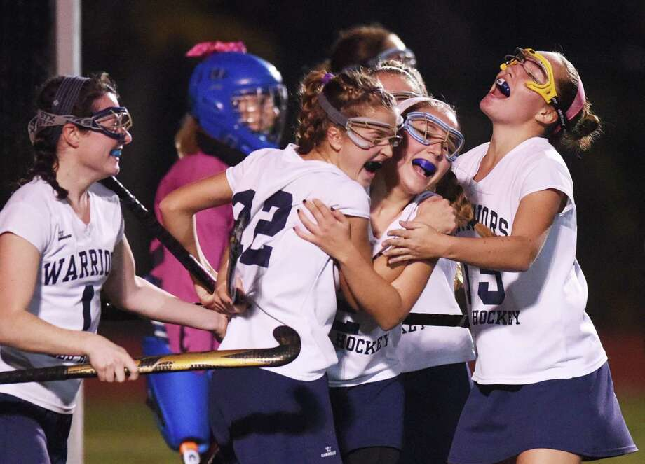 Wilton players, from left, Meg Cunningham, Maddie Duff, Katherine Campbell, and Jillian Mahon celebrate Campbell's goal in Wilton's 2-0 win over Lauralton Hall in the CIAC Class M field hockey semifinal game at Fairfield Ludlowe High School in Fairfield, Conn. Tuesday, Nov. 11, 2014. Photo: Tyler Sizemore / Greenwich Time