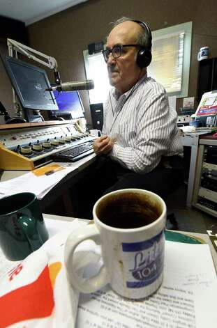 A well-used coffee cup sits idle as radio personality Bob Cudmore works the audio board Tuesday morning, Nov. 11, 2014, as he works in the studios of WVTL in Amsterdam, N.Y.     (Skip Dickstein/Times Union) Photo: SKIP DICKSTEIN / 00029412A