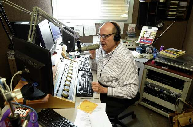 Radio personality Bob Cudmore works the audio board Tuesday morning, Nov. 11, 2014, as he works in the studios of WVTL in Amsterdam, N.Y.     (Skip Dickstein/Times Union) Photo: SKIP DICKSTEIN / 00029412A