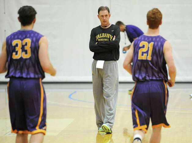 UAlbany head coach Will Brown watches his players warm up during the first basketball practice of the season on Thursday, Oct. 9, 2014 in Albany, N.Y. (Lori Van Buren / Times Union) Photo: Lori Van Buren / 10028939A