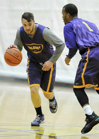 Peter Hooley dribbles the ball during the first basketball practice of the season for the UAlbany men on Thursday, Oct. 9, 2014 in Albany, N.Y. (Lori Van Buren / Times Union) Photo: Lori Van Buren / 10028939A