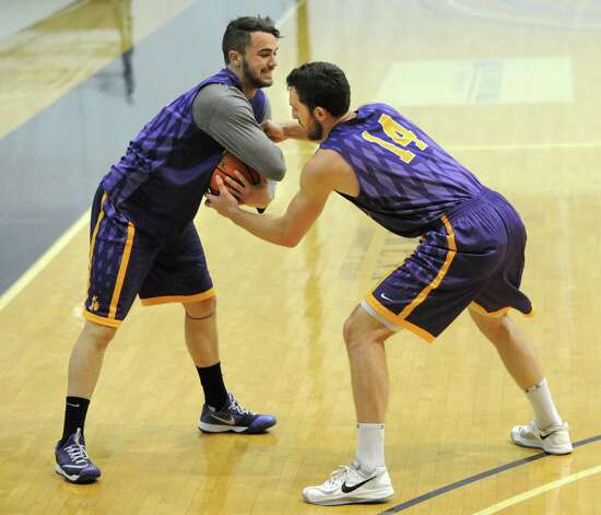 Peter Hooley, left, tries to keep the ball away from Sam Rowley during the first basketball practice of the season for the UAlbany men on Thursday, Oct. 9, 2014 in Albany, N.Y. (Lori Van Buren / Times Union) Photo: Lori Van Buren / 10028939A