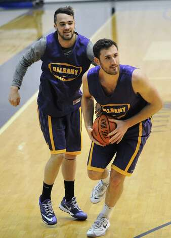Peter Hooley, left, gets the ball stripped away from him by Sam Rowley in a drill during the first basketball practice of the season for the UAlbany men on Thursday, Oct. 9, 2014 in Albany, N.Y. (Lori Van Buren / Times Union) Photo: Lori Van Buren / 10028939A