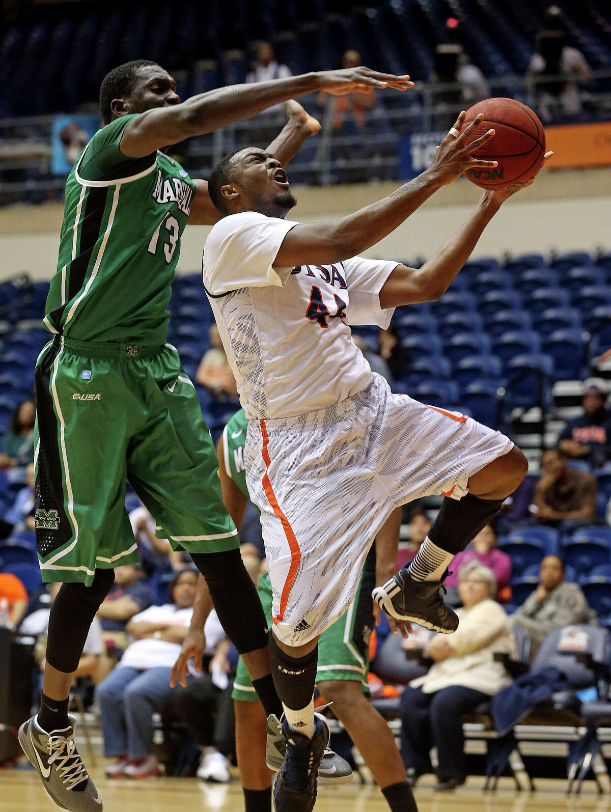 Keon Lewis beats Marshall big man Cheikh Sane to the hoop at the UTSA Convocation Center in 2014. Lewis is expected to be one of the main contributors to the Roadrunners' offense in 2014-15.