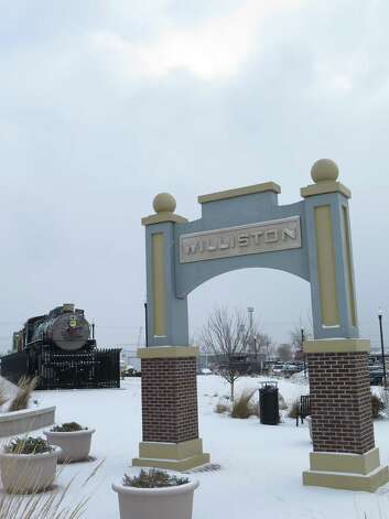 An arch welcoming people near Williston, N.D.'s Amtrak station is seen on Tuesday, Nov. 11, 2014. Tuesday morning saw temperatures in the single digits and a light snowfall. (AP Photo/Josh Wood) ORG XMIT: RPJW102 Photo: Josh Wood / AP