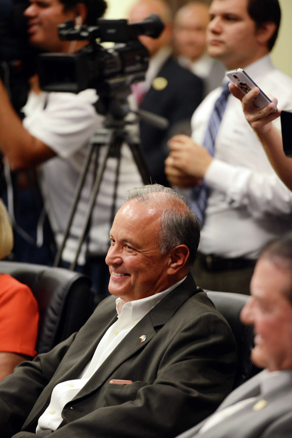 Cameron County Judge Carlos Cascos smiles after Governor-elect Gregg Abbott announced him as the new Texas secretary of state in Brownsville, Texas on Tuesday, Nov. 11, 2014. Cascos was re-elected county judge in the recent election. (AP Photo/The Brownsville Herald, Brad Doherty)