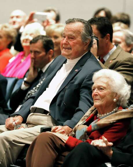 "Former President George H.W. Bush and his wife Barbara Bush hold hands as they listen to their son former president George W. Bush discuss his new book, ""41: A Portrait of My Father"" at the his father's presidential library Tuesday, Nov. 11, 2014, in College Station, Texas. (AP Photo/Texas Tribune, Bob Daemmrich, Pool) Photo: Bob Daemmrich, POOL / Pool, Bob Daemmrich"