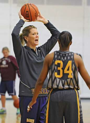 UAlbany women's basketball head coach Katie Abrahamson-Henderson goes over a drill with her players at practice on Tuesday, Nov. 11, 2014 in Albany, N.Y. (Lori Van Buren / Times Union) Photo: Lori Van Buren / 00029438A