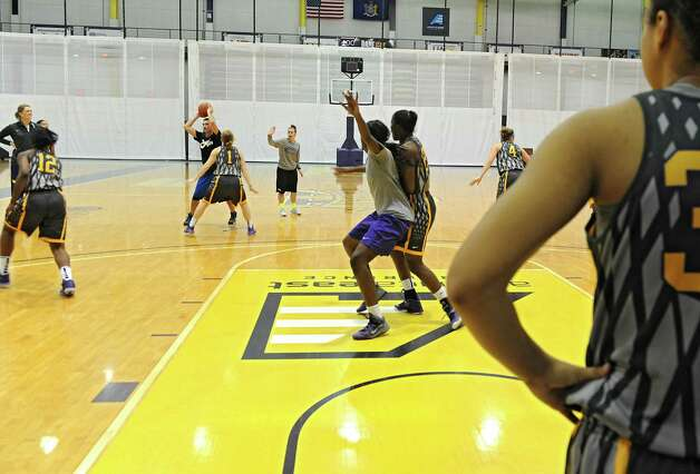 The UAlbany women's basketball team runs a drill at practice on Tuesday, Nov. 11, 2014 in Albany, N.Y. (Lori Van Buren / Times Union) Photo: Lori Van Buren / 00029438A