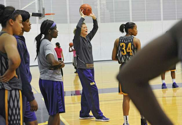 UAlbany women's basketball head coach Katie Abrahamson-Henderson, center, talks to her players during a drill at practice on Tuesday, Nov. 11, 2014 in Albany, N.Y. (Lori Van Buren / Times Union) Photo: Lori Van Buren / 00029438A