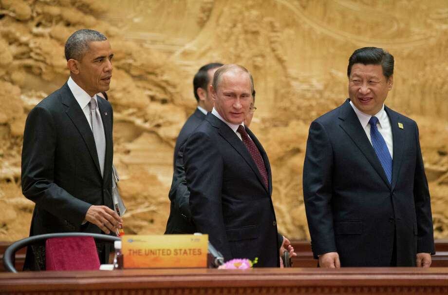 President Barack Obama joins Russian President Vladimir Putin and Chinese President Xi Jinping on Tuesday at the the Asia-Pacific summit in Beijing. Photo: Pablo Martinez Monsivais, POOL / AP