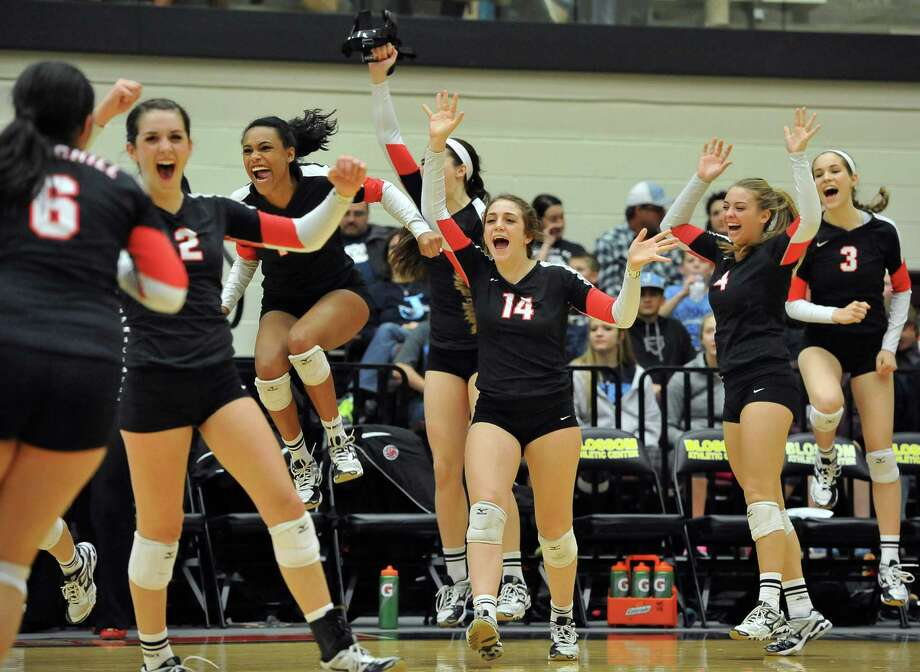 Churchill players celebrate their Class 6A playoff win over Johnson at Littleton Gym. Churchill won in three straight sets. Photo: Darren Abate, FRE / Express-News