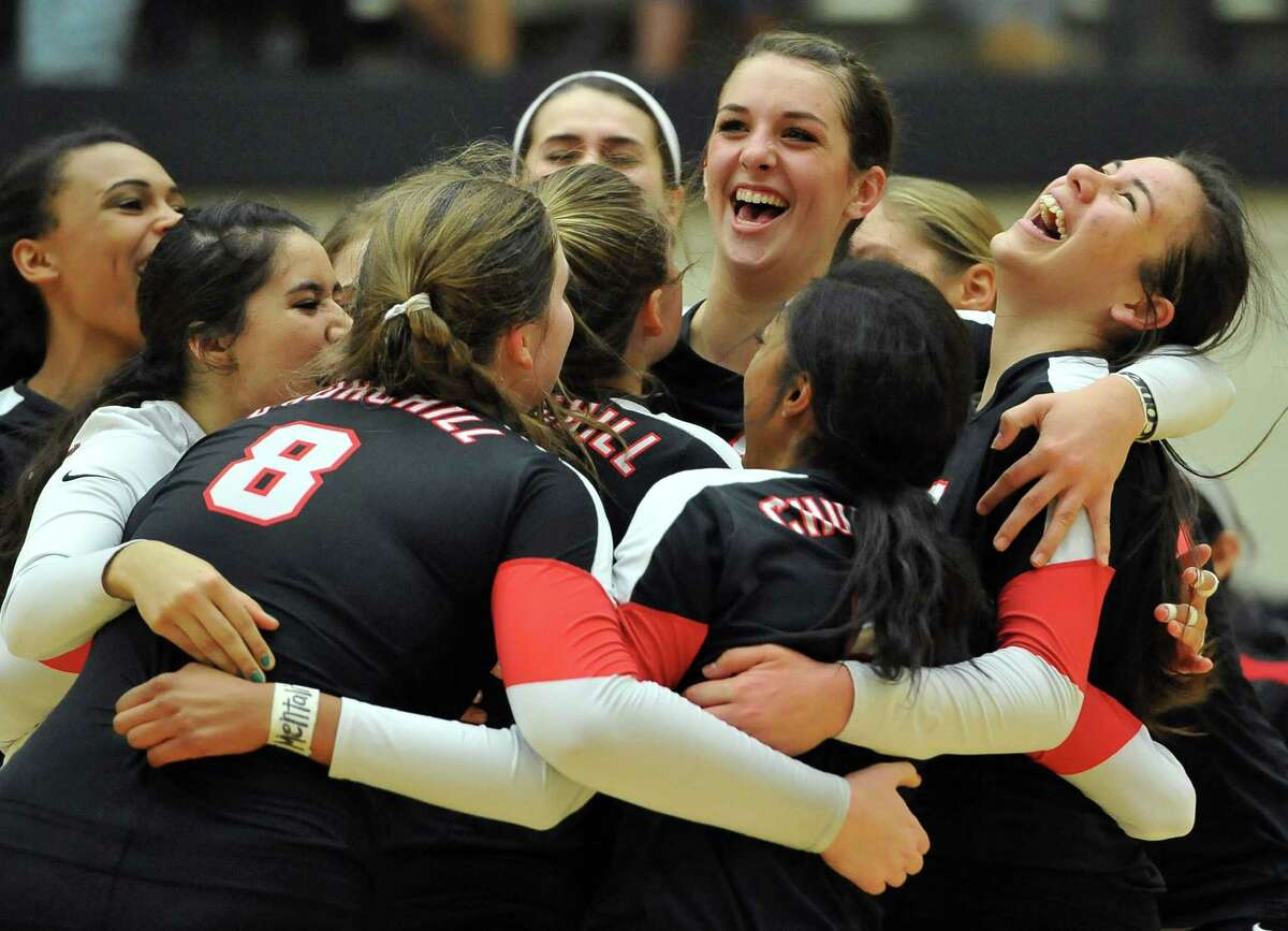 Churchill players celebrate their Class 6A playoff win over Johnson at Littleton Gym. Churchill won in three straight sets.