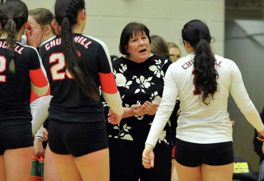 Churchill coach Jo Anne Hultgren talks to her team during a high school volleyball playoff match against Johnson on Nov. 11, 2014. Photo: Darren Abate /For The Express-News