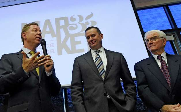 Jerry Golub, CEO, left, with Scott Grimmett, COO, center, and Neil Golub, executive chairman of the board of Price Chopper announce a brand name change for the company Tuesday morning Nov. 11, 2014 at their headquarters in Schenectady, N.Y.     (Skip Dickstein/Times Union) Photo: SKIP DICKSTEIN / 00029424A