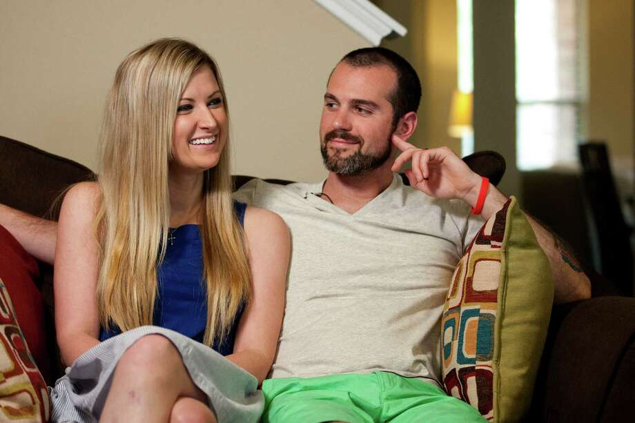 Portrait of Pete 29, and Rebekah DiMartino, 26, who survived the bombing attack at the Boston Marathon, at their new home Thursday, May 8, 2014, in Richmond. Pete and Rebekah were dating at the time of the bombing when they were cheering on Pete's mother near the finish line. Gregory has endured 16 surgeries and may have to have her left leg amputated after one more surgery in an attempt to save it. DiMartino's had surgeries to repair his Achilles tendon. In the meantime, the couple were engaged and married in a fairytale wedding at the Biltmore Estate in Asheville, N.C. The couple moved to Richmond to be close to Rebekah's family. ( Johnny Hanson / Houston Chronicle ) Photo: Johnny Hanson / © 2014  Houston Chronicle