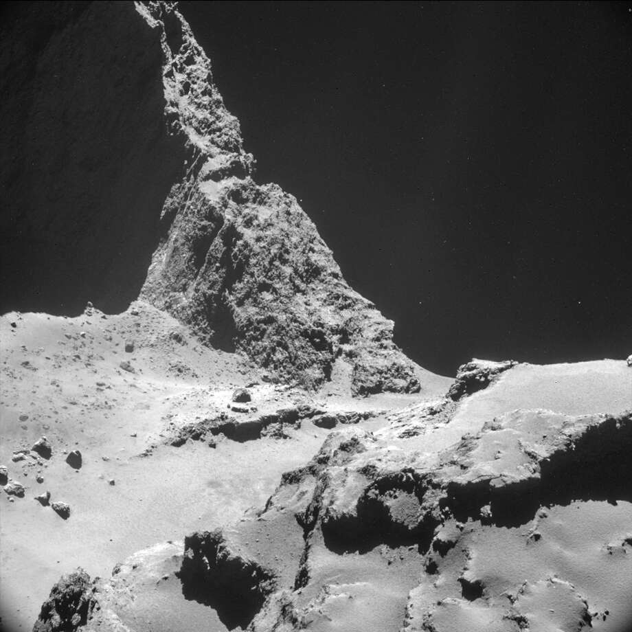 The picture taken with the navigation camera on Rosetta and released by the European Space Agency ESA shows the boulder-strewn neck region of 67P/Chur-yumov-Gerasimen-ko. , with the smaller lobe on the left and the larger lobe on the right. It was captured from a distance of 9.7 km from the center of the comet (about 7.7 km / 4.8 miles) from the surface) on Oct. 28, 2014. On Wednesday, Nov. 12, 2014 the Philae lander will be detached from Rosetta to land on the comet. (AP Photo/ESA) Photo: Associated Press / ESA/Rosetta/NavCam