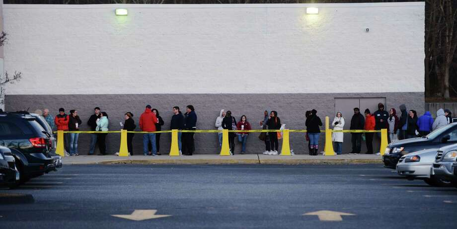 Consumers wait to shop in Waterford, Conn., on Thanksgiving Day last year. Photo: SEAN D. ELLIOT, MBR / THE DAY