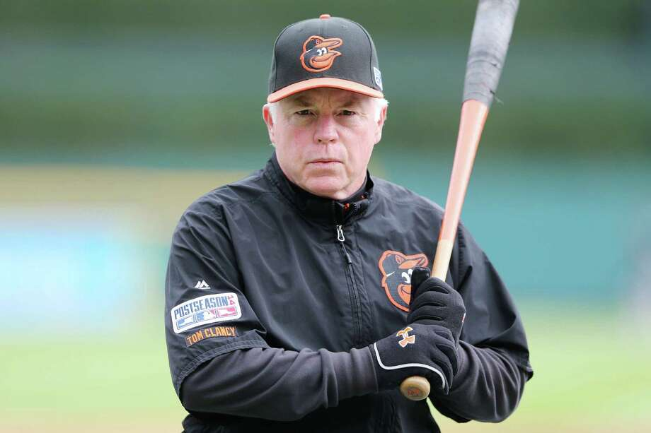 FILE - NOVEMBER 11, 2014: Baltimore Orioles manager Buck Showalter named American League Manager of the Year. DETROIT, MI - OCTOBER 05:  Manager Buck Showalter #26 of the Baltimore Orioles looks on during batting practice prior to Game Three of the American League Division Series against the Detroit Tigers at Comerica Park on October 5, 2014 in Detroit, Michigan.  (Photo by Leon Halip/Getty Images) Photo: Leon Halip, Stringer / 2014 Getty Images