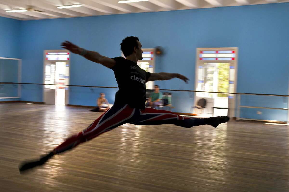 In this Oct. 29, 2014 photo, Cuban dancer Javier Torres practices at the National Cuban Ballet dance house in Havana, Cuba. Torres, a star dancer with the Northern Ballet of Great Britain, said the spirit of their homeland shapes their art no matter how far they travel.