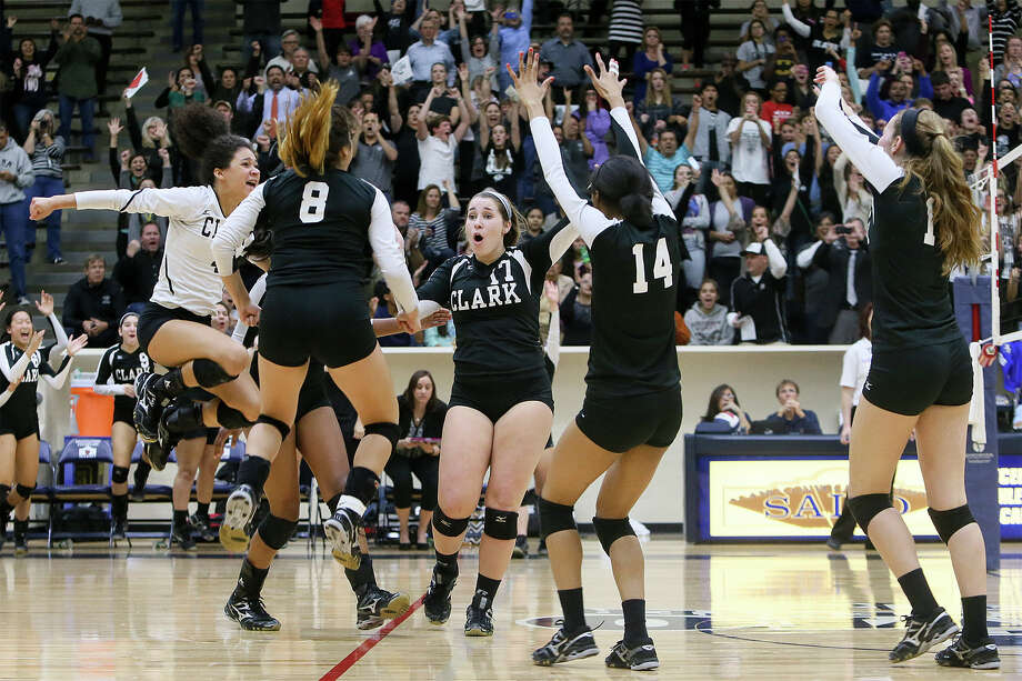 Clark players celebrate during their Class 6A regional quarterfinals match at Alamo Convocation Center. Clark beat Canyon 25-18, 20-25, 26-24. 25-13. Photo: Marvin Pfeiffer, Staff / San Antonio Express-News / Express-News 2014