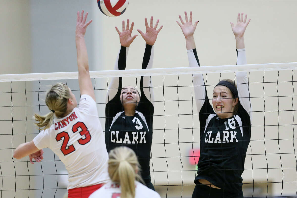 Clark's Lindsey McDonough (from right) and Harper Stone try to block a shot by New Braunfels Canyon's K.K. Payne.