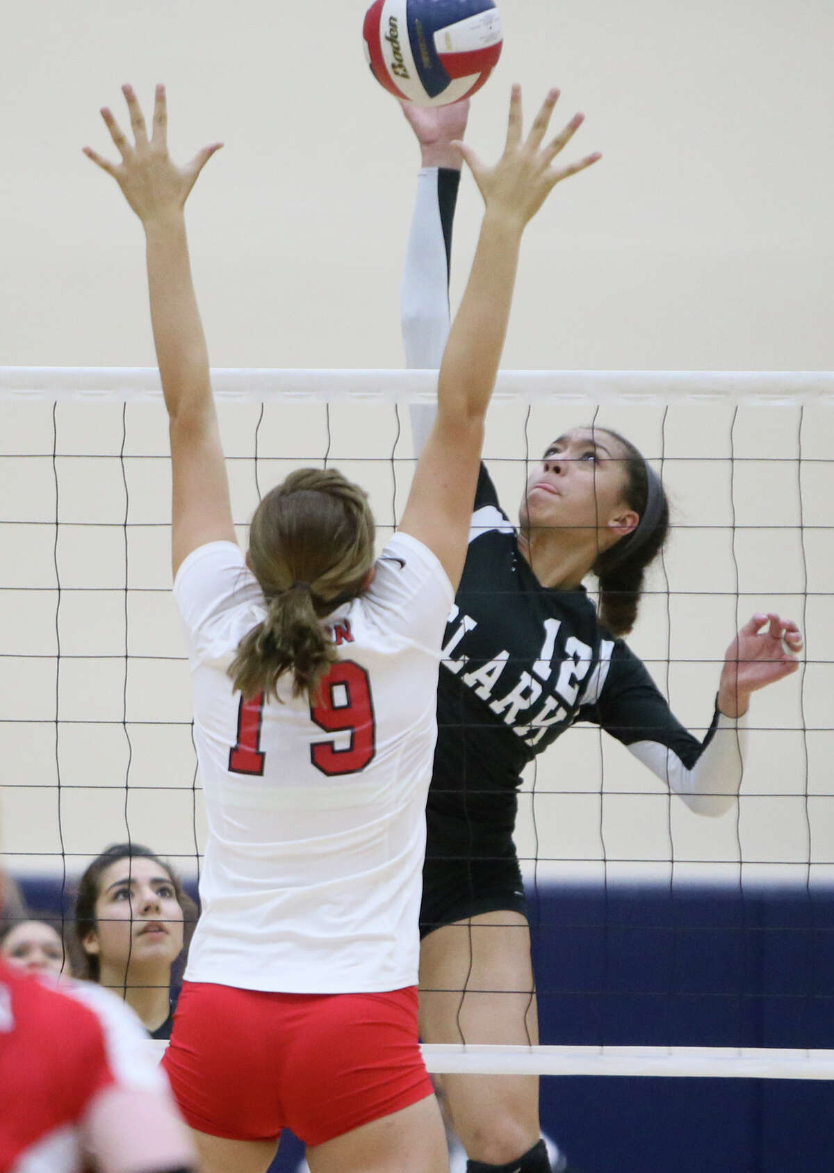 Clark's Maylin Garrett (right) tries to get a shot past New Braunfels Canyon's Brooke Vestal during their Class 6A regional quarterfinals match at Alamo Convocation Center on Tuesday, Nov. 11, 2014. Clark beat Canyon in four sets: 25-18, 20-25, 26-24 and 25-13. MARVIN PFEIFFER/ mpfeiffer@express-news.net