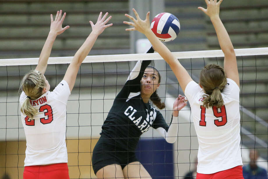 Clark's Maylin Garrett (center) shoots between New Braunfels Canyon's K.K. Payne (left) and Brooke Vestal during their Class 6A regional quarterfinals match at Alamo Convocation Center on Tuesday, Nov. 11, 2014. Photo: Marvin Pfeiffer /San Antonio Express-News / Express-News 2014