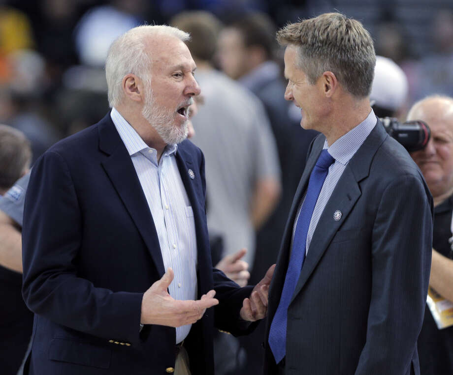 Steve Kerr (right) played for Gregg Popovich in San Antonio, but Kerr lost to him as a coach in Tuesday's Warriors game. Photo: Carlos Avila Gonzalez / The Chronicle / ONLINE_YES