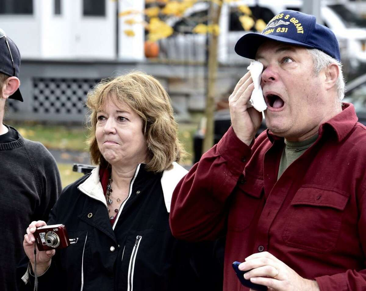 Dave and Kathy VanAcken get emotional as they watch the tree they donated to the state leave for the Empire State Plaza. (Skip Dickstein / Times Union)