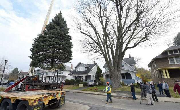 The state holiday tree leaves the front lawn of the VanAcken family in Schenectady. (Skip Dickstein / Times Union)