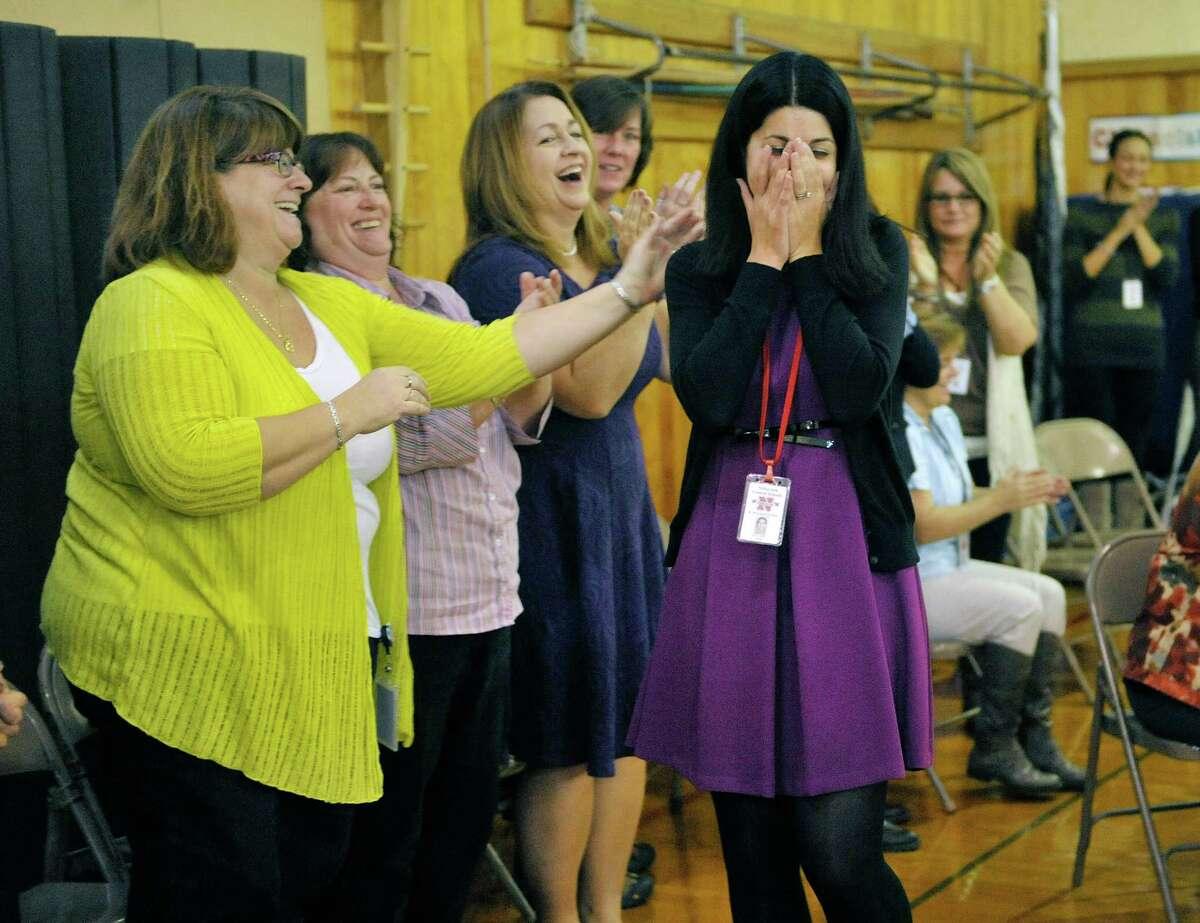 Rosendale Elementary School fourth grade teacher Roseann Maurantonio reacts as she is announced as a Milken Educator Award recipient Wednesday morning, Nov. 12, 2014, at Rosendale Elementary School in Niskayuna, N.Y. (Paul Buckowski / Times Union)
