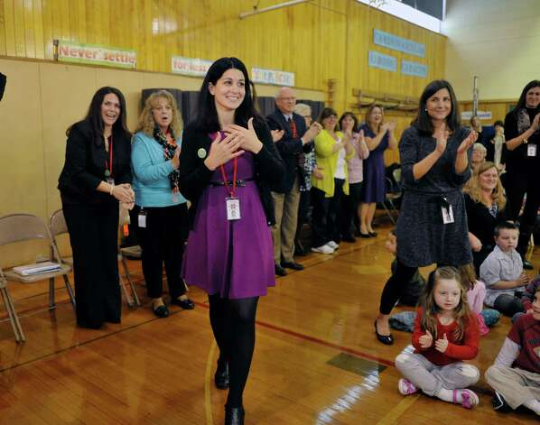 Rosendale Elementary School fourth grade teacher Roseann Maurantonio reacts as she is announced as a Milken Educator Award recipient Wednesday morning, Nov. 12, 2014, at Rosendale Elementary School in Niskayuna, N.Y.   (Paul Buckowski / Times Union) Photo: Paul Buckowski / 00029448A