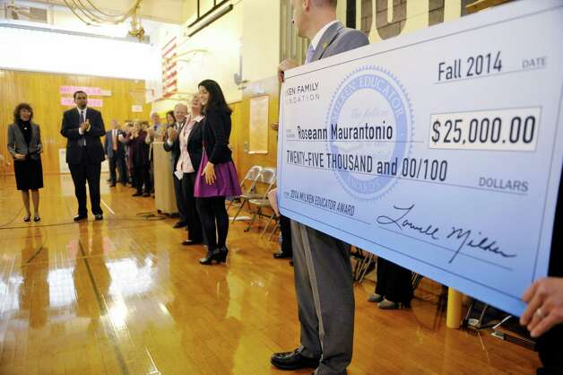 Rosendale Elementary School fourth grade teacher Roseann Maurantonio, background center, receives the a Milken Educator Award Wednesday morning, Nov. 12, 2014, at Rosendale Elementary School in Niskayuna, N.Y.   (Paul Buckowski / Times Union) Photo: Paul Buckowski / 00029448A