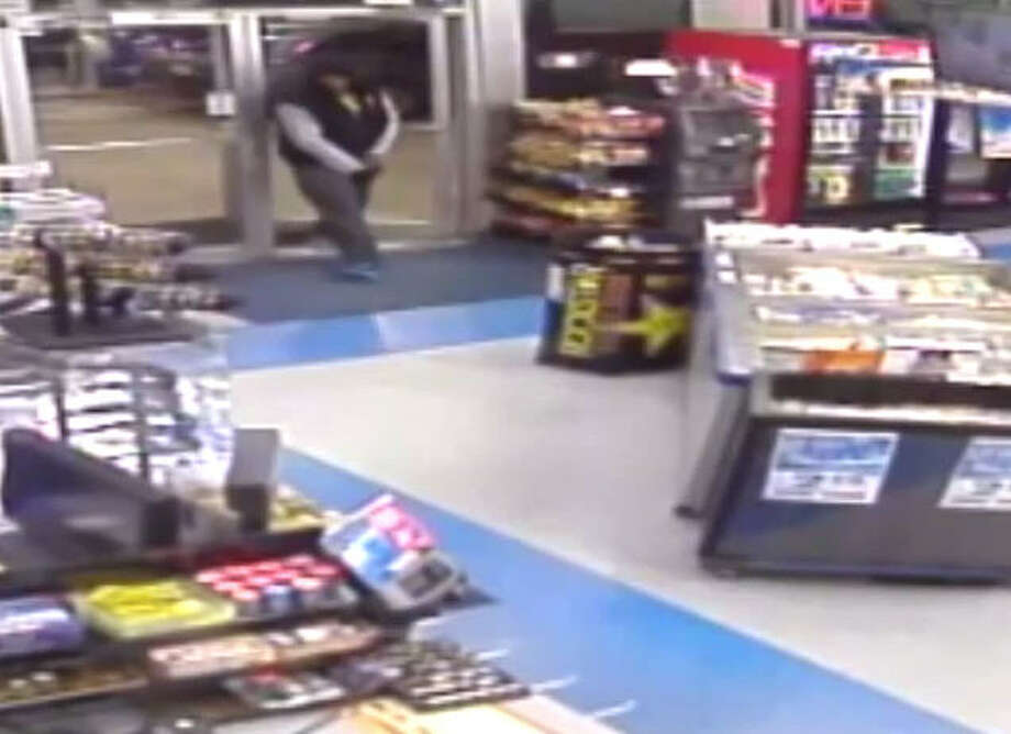 On October 10, 2014, this man entered a gas station in the 13500 block of Alief Clodine Road and robbed the cashier at gunpoint, pistol-whipping the clerk on the way out. | Crime Stoppers of Houston Photo: Crime Stoppers Of Houston
