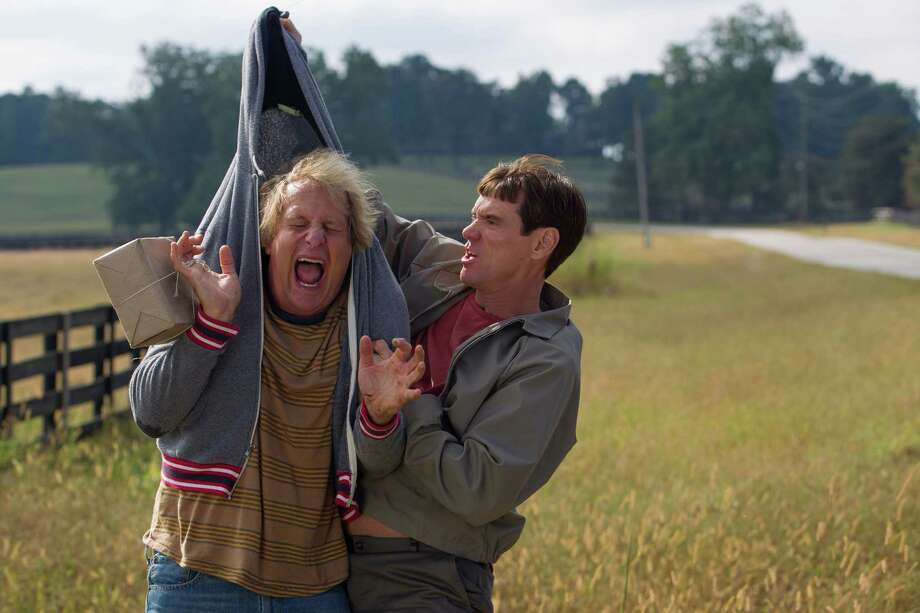 "Jeff Daniels and Jim Carrey reprise their signature roles as Harry and Lloyd in the sequel to the smash hit that took physical comedy and kicked it in the nuts, ""Dumb and Dumber To."" (Photo courtesy Universal Studios/MCT) Photo: Handout, HO / MCT"