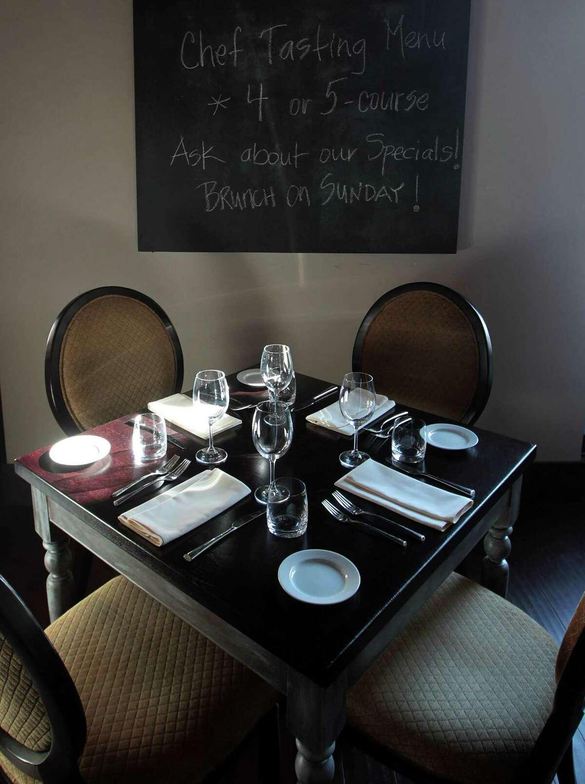 A table at Etoile cuisine et bar Wednesday, Jan. 16, 2013, in Houston. ( James Nielsen / Chronicle )