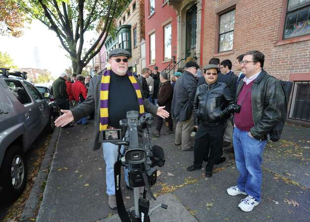 """Jazz writer and radio host Jay Hunter gives a video review of the days event as a collection of Capital Region jazz musicians gather for a group photo inspired by the historic Art Kane photo, """"Harlem 1958,"""" which was the subject of the documentary """"A Great Day in Harlem,"""" Saturday Nov. 8, 2014, on Madison Avenue in Albany, N.Y.Pete Sweeney, Bill Leary, Thomas Bellino, Brian Patneaude, Andrzej Pilarczyk, Dylan Canterbury, Susan Brink, Heather Jakeman, Chris Pasin, Rudy Lu, Pete Sweeney, Corey Aldrich, Tim Olsen, Dylan Perrillo, Keith Pray, Tim Coakley, michael wooten, Bill McCann, Skip Parsons, Tom Pierce, Jay Hunter, JosA© E. Cruz, Pat Viglucci, William Knauer, , Kristin Diotte, Joscelyn Pidgeon Clark, Jerry Gordon, Charlie Vatalaro, Jeff Nania, Andrew Gardner, Livio Fasullo and John Dimase. (Michael P. Farrell/Times Union) Photo: Michael P. Farrell / 00029343A"""